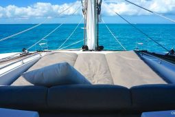 Caribbean Bahamas Lagoon 62 ft Sailing Catamaran flybridge seating and sunbathing area